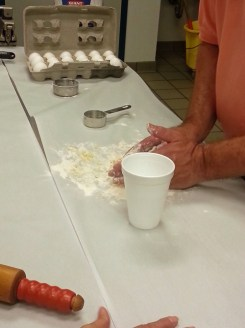 Sprinkle some water in. Mix/knead