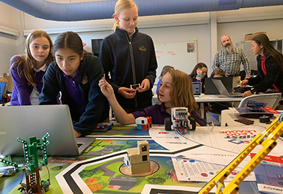 Middle School students participate in a science enrichment experiment after school.