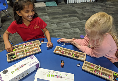 Lower School students at The Summit Prep build a robotics kit together during an enrichment lesson.