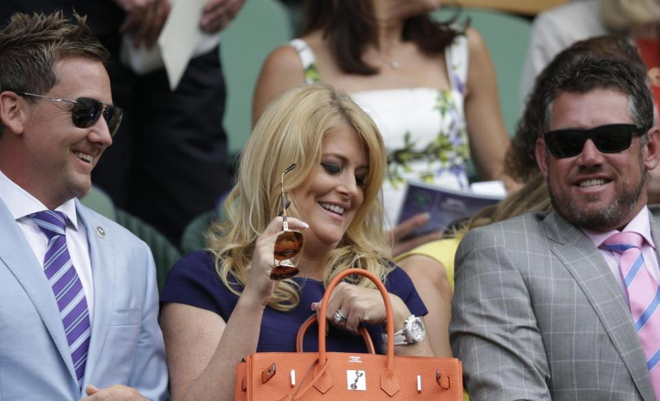 Golfer Ian Poulter and his wife Katie at Wimbledon, with fellow pro Lee Westwood