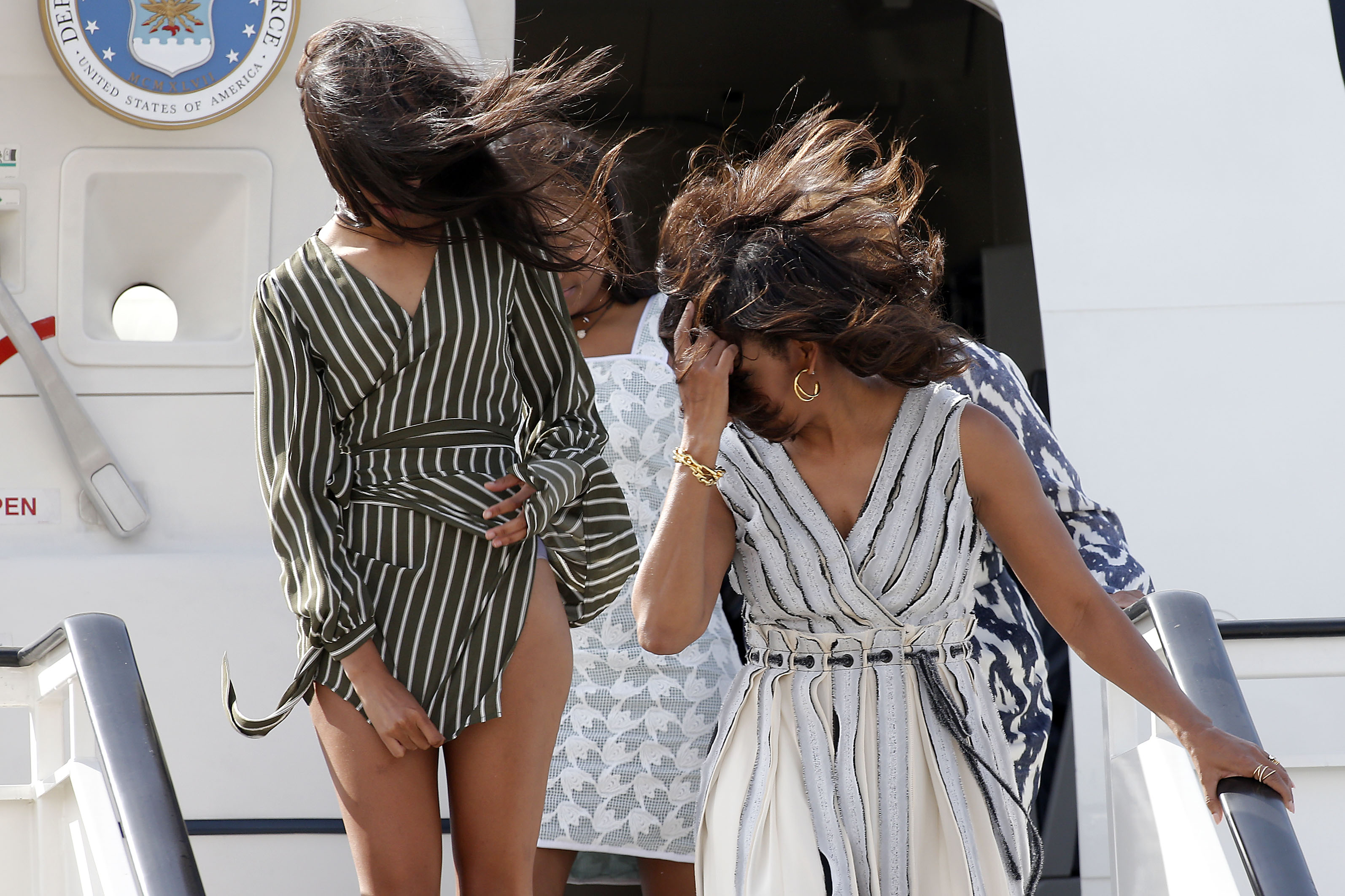 First lady Michelle Obama, her two daughters and her mother arrive at MAD