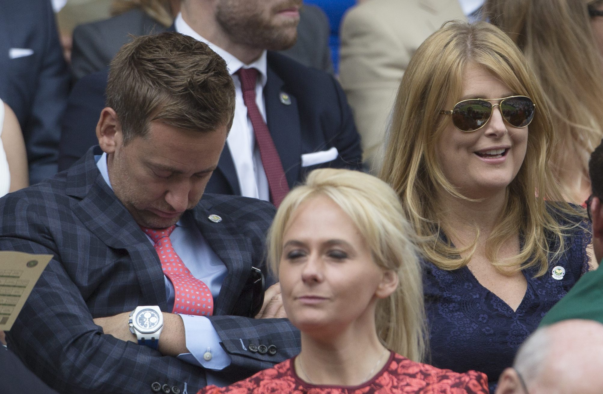 Poulter nods off while Katie stays glued to the tennis at Centre Court