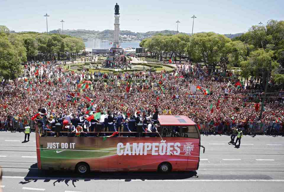 The Portugal pl;ayers ride back on the open-top bus
