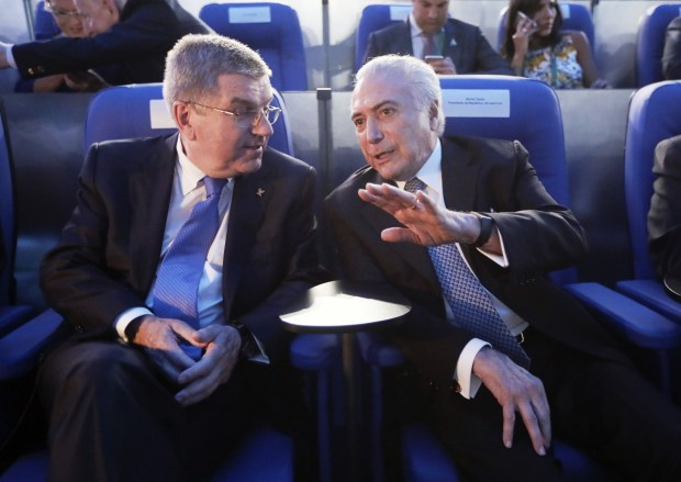 International Olympic Committee president Thomas Bach and Brazil interim president Michel Temer watch the ceremony
