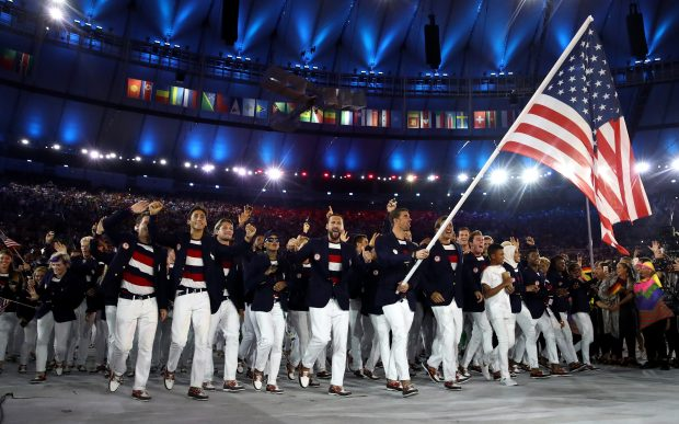 Swimming legend Michael Phelps leads the United States team into the Maracana