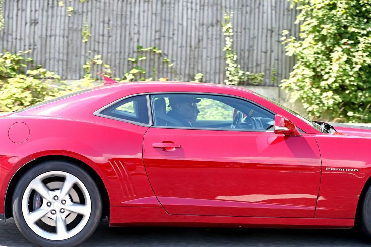 Paul Pogba arrives at Carrington in a red Chevrolet