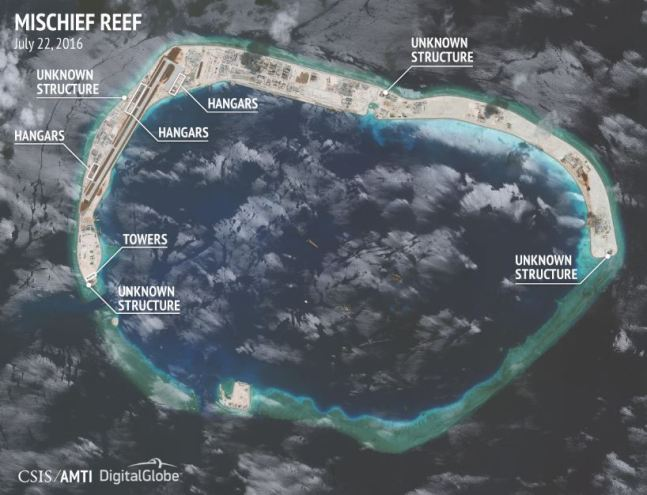 Nearby Mischief Reef also has a runway lined with military-grade aircraft hangars