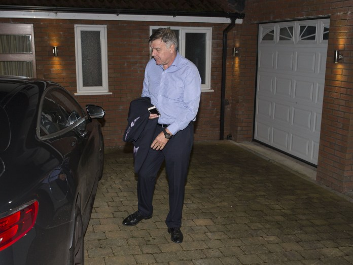 He locks his car after parking at his home in Bolton