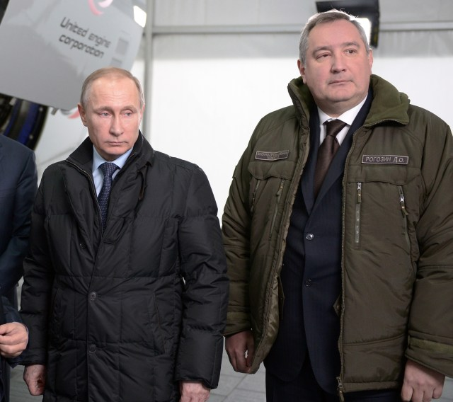 Russian Deputy Prime Minister Dmitry Rogozin, pictured here alongside President Vladimir Putin, says his country will develop legions of robots and drones to fight its enemies