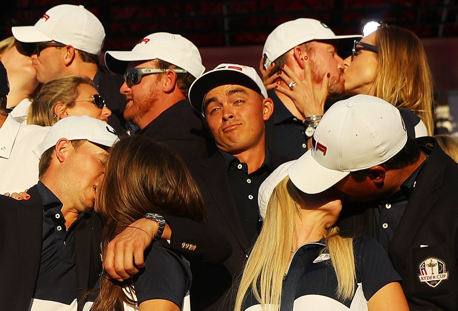 Rickie Fowler, who didn't take a Wag to the Ryder Cup, looks lonely as teammates enjoy a kiss