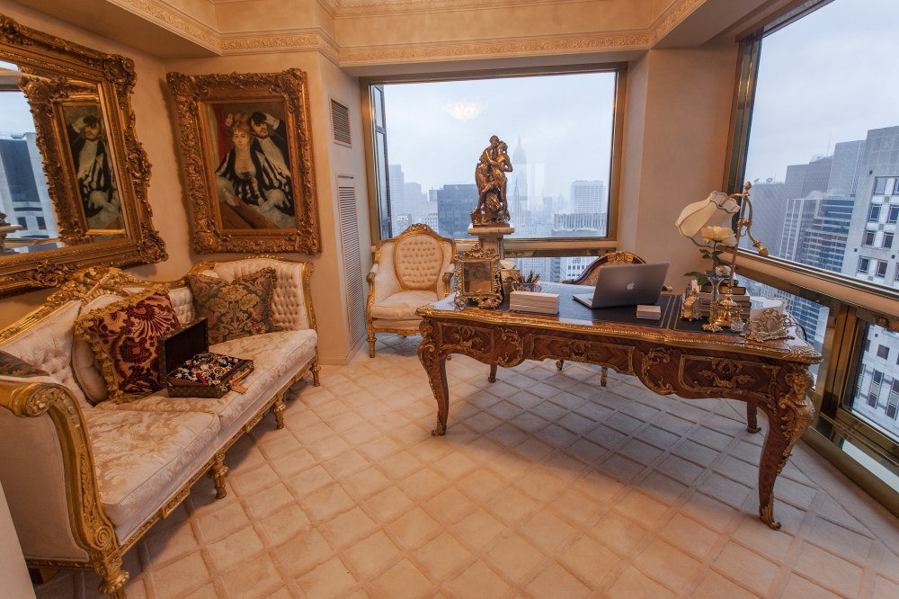 Trump's three-level penthouse apartment on the 66th floor boasts spectacular views across the city, as can be seen here from his grand office. On the wall sits a a reproduction of Renoir's La Loge - the original is in the Courtald gallery in London - while his desk which features a container of coloured pencils was inspired by Louis XIV