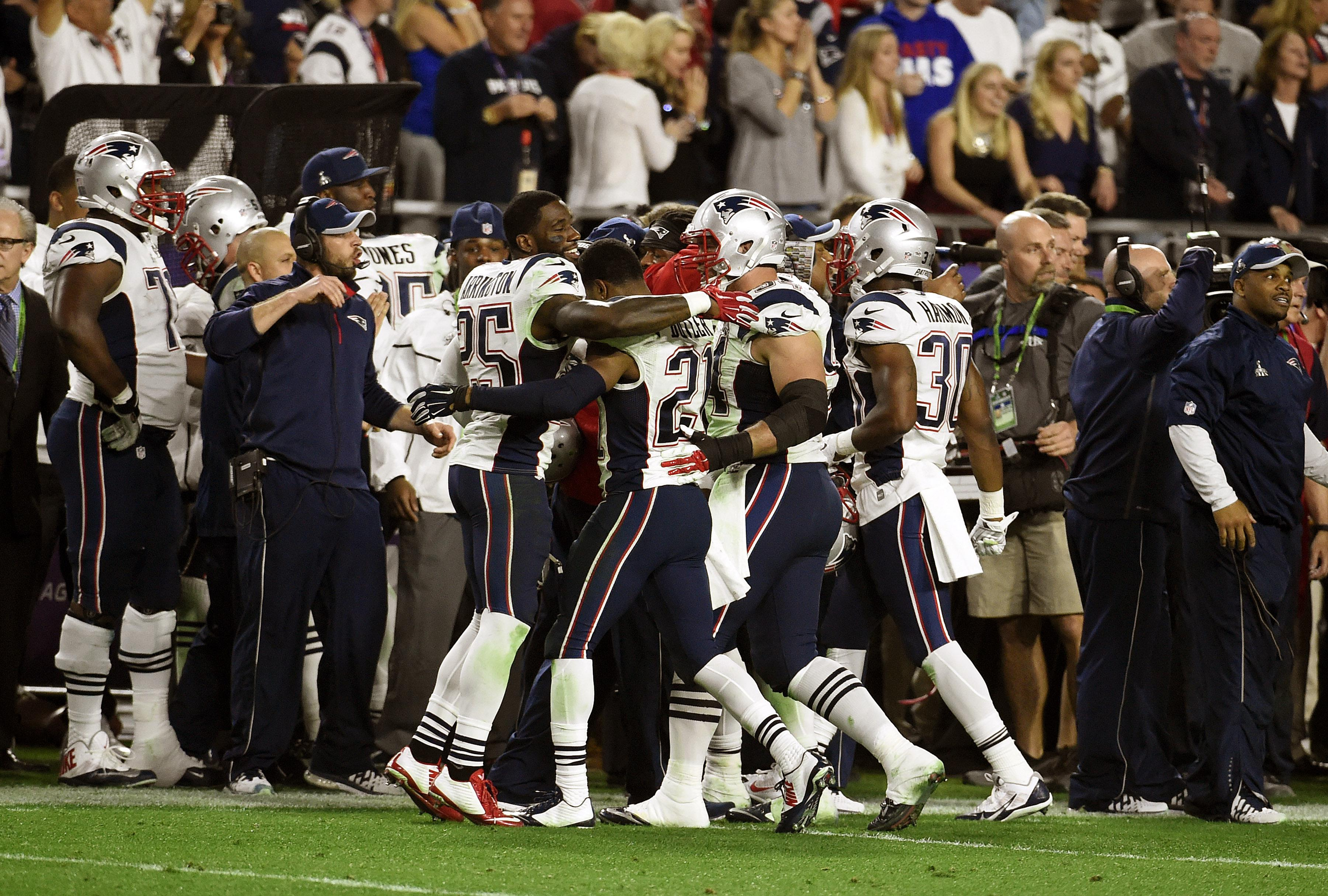 Butler is congratulated by his team-mates after his interception in Super Bowl 49