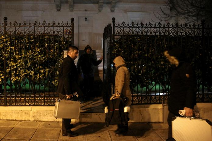 Police were pictured entering the flat of Andrey Malanin as Greek police confirmed the murder squad would examine the case