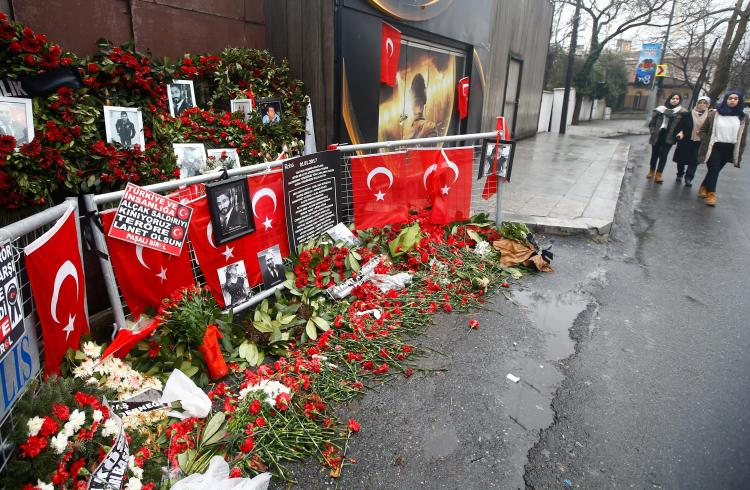 REUTERS : Tributes laid outside the Istanbul nightclub in Istanbul where 35 people were killed