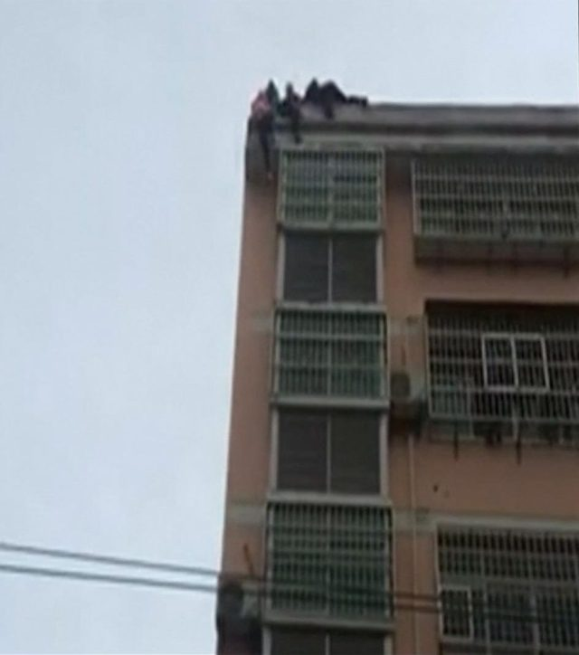 His wife tried to jump off the building at Shiquan County in Ankang, a city in north-western China's Shaanxi Province