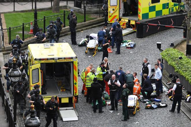 Emergency services rush to the aid of those critically injured in Parliament ground in the aftermath of the attack