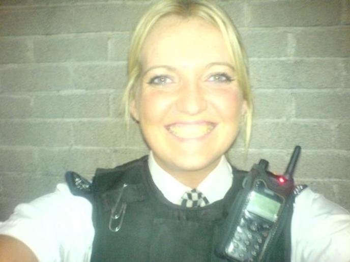 The blonde-haired PC was arrested along with PC Adam Jackson, 35