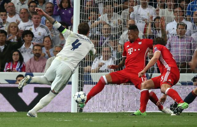 Jerome Boateng stops Sergio Ramos from finding the back of the net as he cleared the ball off the line