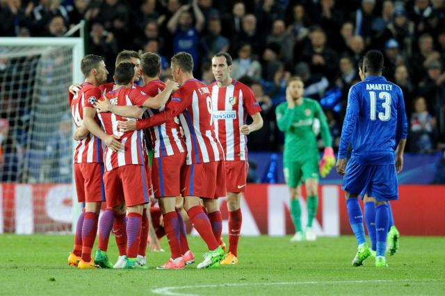 Atletico players celebrate at the final whistle