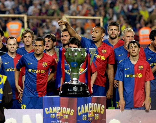 Barcelona players celebrate after winning La Liga in Pep Guardiola's first season