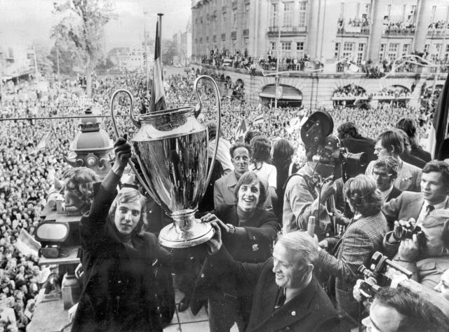 Ajax players celebrate with the European Cup after winning Treble in 1972