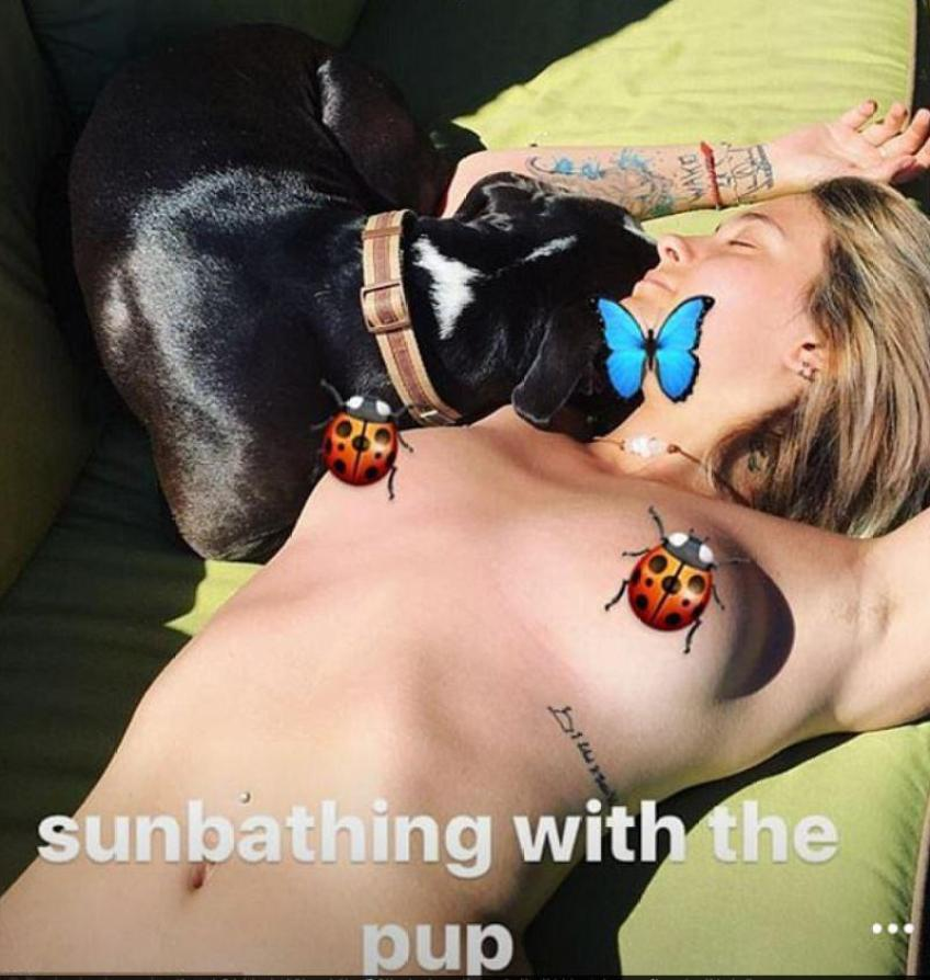 Paris posted a cheeky topless pic to her Instagram moments as she lay in the sun