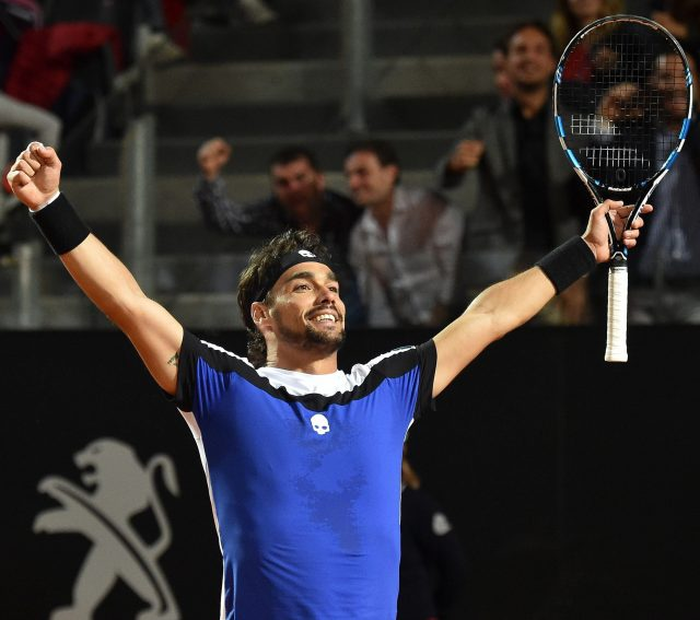 Home favourite Fabio Fognini celebrates victory over defending champ Andy Murray in the Italian Open