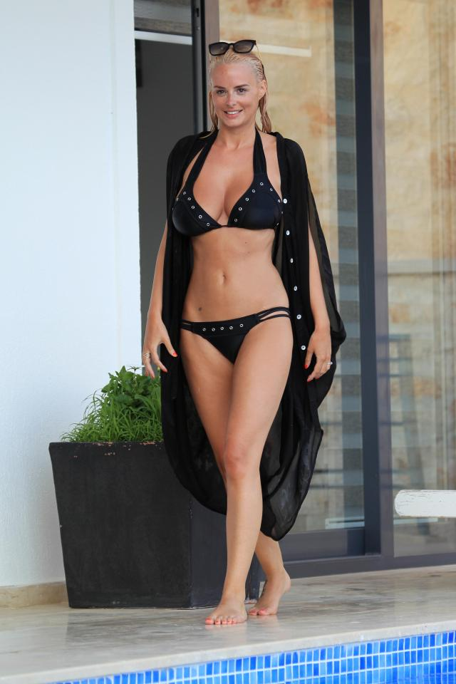 Rhian Sugden snapped by the pool on holiday in Turkey