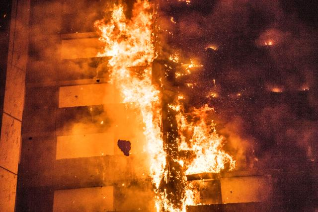 The fire ripped through the tower block in the early hours of the morning killing at least 12