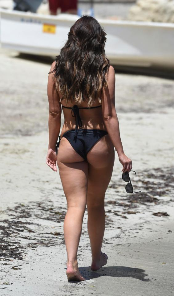 Vicky's bikini flashed her perky bum as she enjoyed her trip