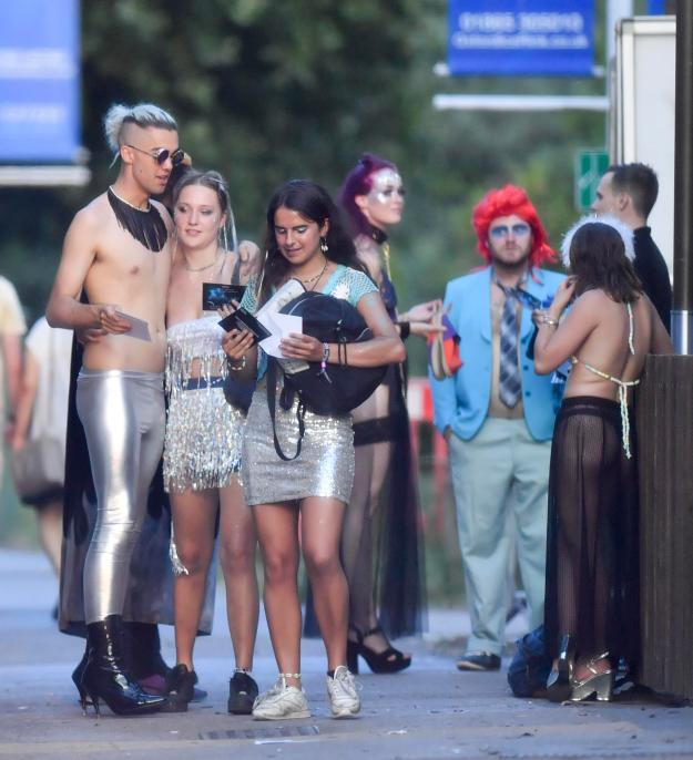 Ben Christopher, left, went topless with wet-look metallic silver leggings and black leather heeled boots for the 'cosmic space sexy' theme