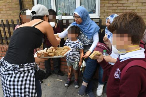 Families caught up in the catastrophe offered sandwiches from strangers in the community who have rallied to help
