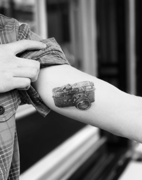 His second tattoo, a camera on his arm, paid tribute to the teen's love of photography