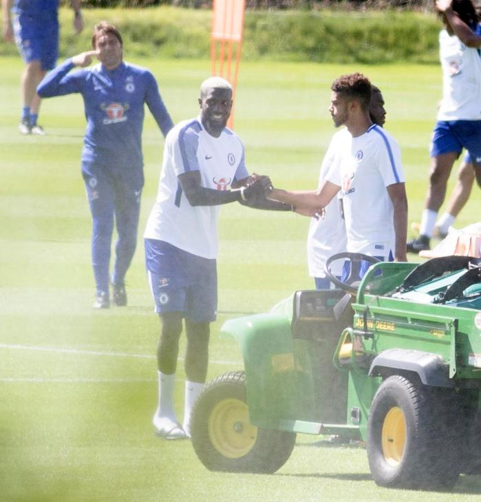 Tiemoue Bakayoko smiles as he greets his new team-mates