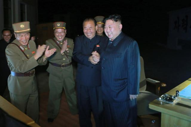 Kim Jong-un celebrates with his generals after the latest Hwasong-14 missile test
