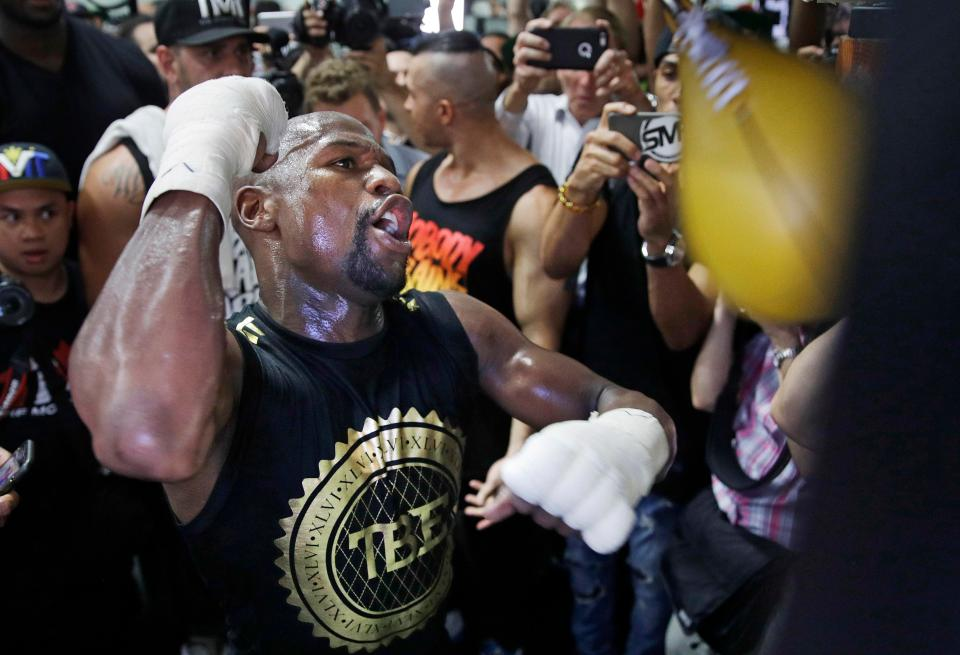 Floyd Mayweather fine-tunes his skills on a punching bag