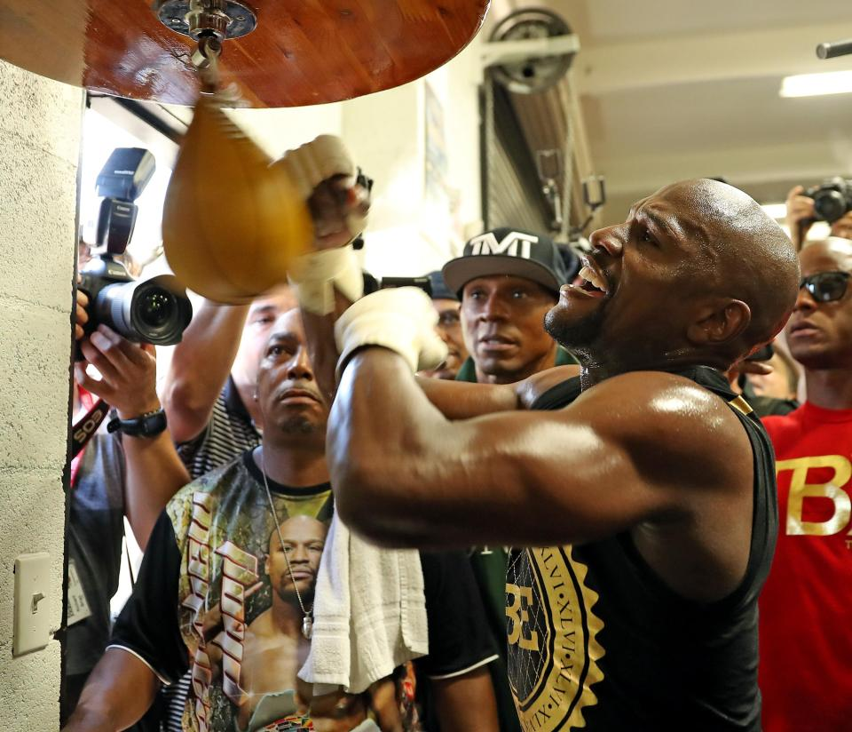 Floyd Mayweather looks in top shape ahead of his mega-fight against Conor McGregor this month