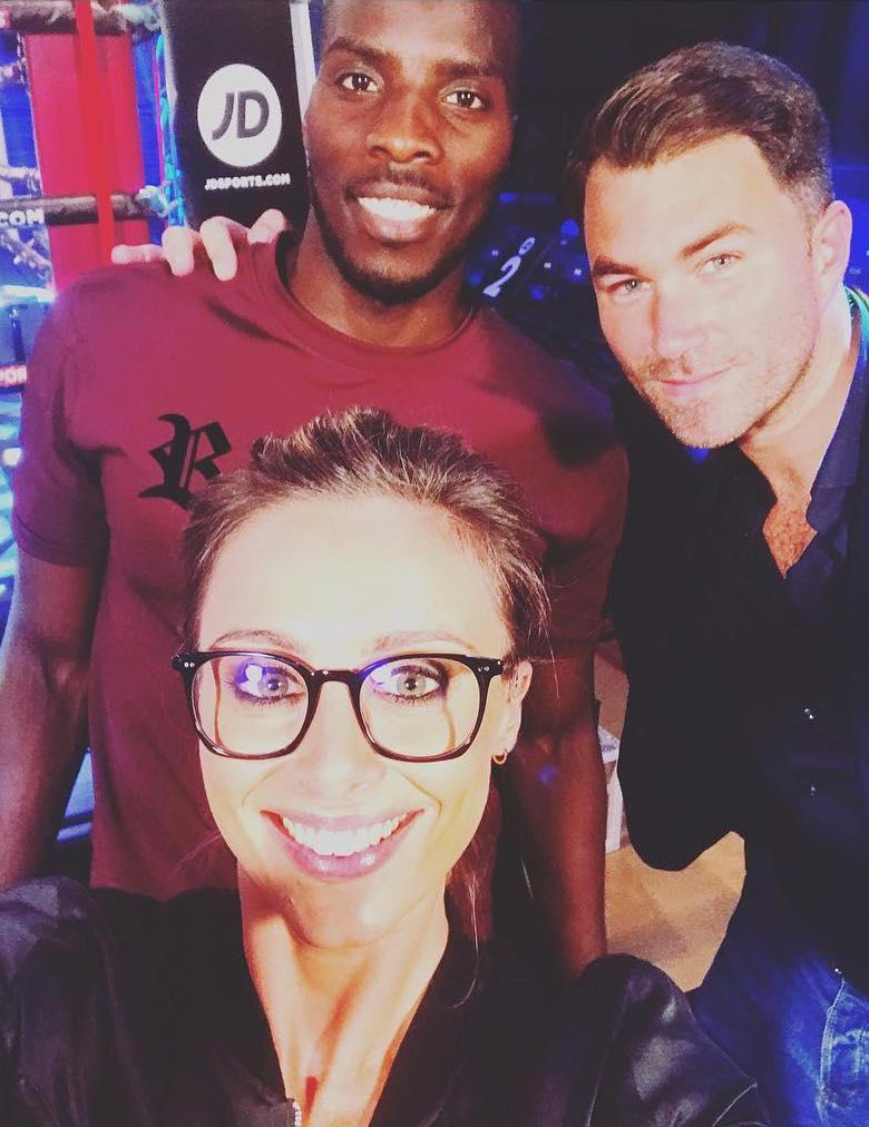 Here Anna Woolhouse stands with one of Eddie Hearn's (right) next big prospects Lawrence Okolie (left)