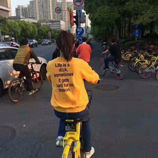 A cyclist was spotted riding around town in this hilariously inappropriate sweater