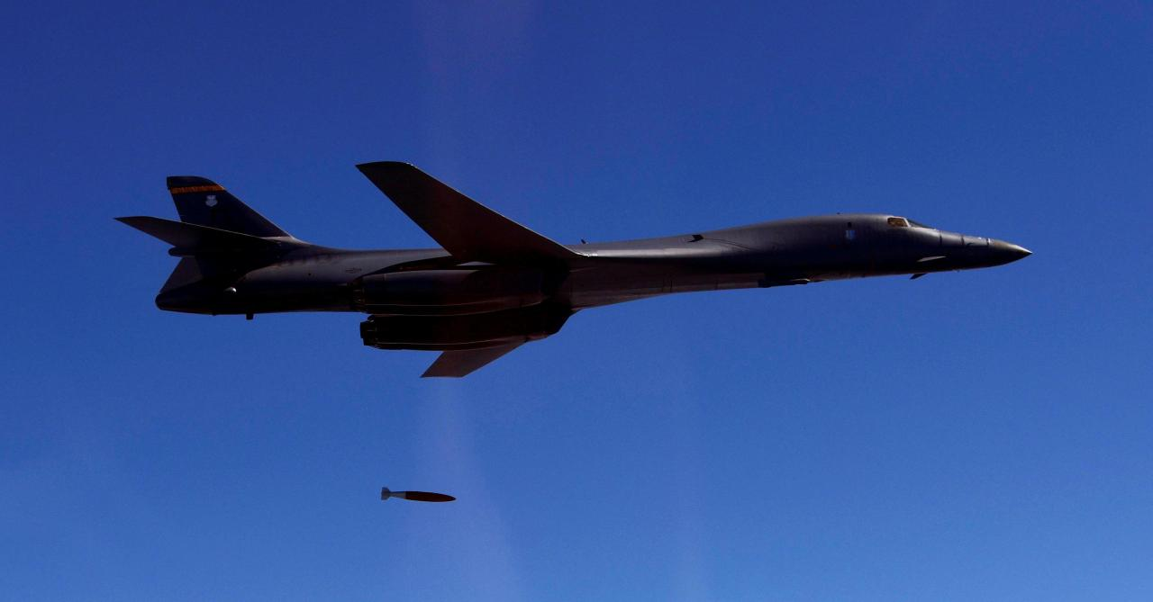 A US Air Force B-1B drops a MK-84 as it flies over South Korea during the joint military drill