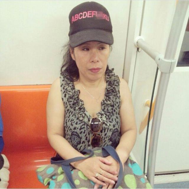 This woman was photographed wearing a naughty slogan cap on the subway