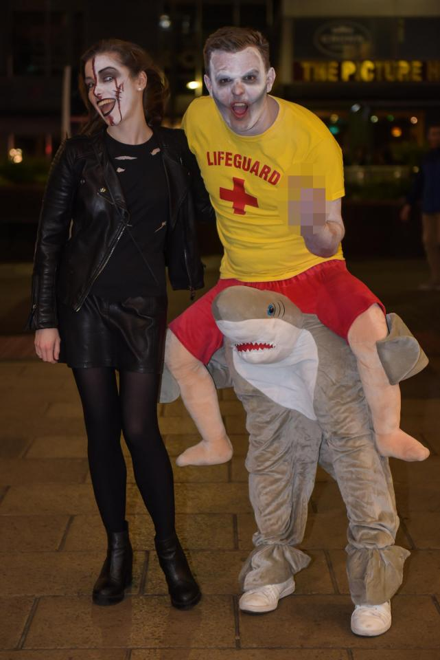 One party-goer dressed as a lifeguard tackling a shark