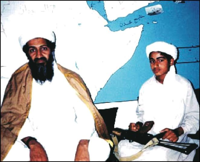 Osama bin Laden pictured with one of his sons