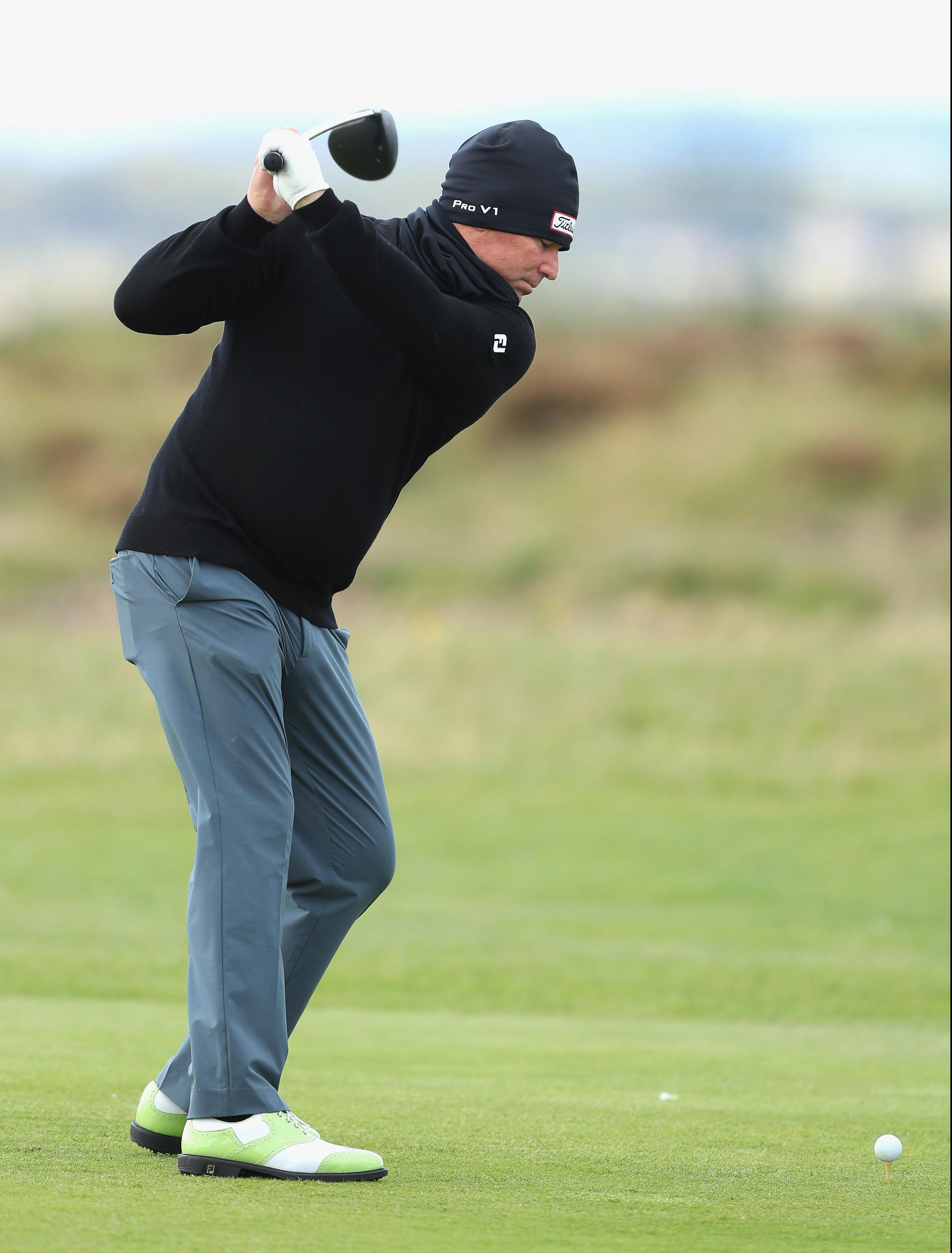 Shane Warne is 11 under in a three-way tie at the top of the leaderboard
