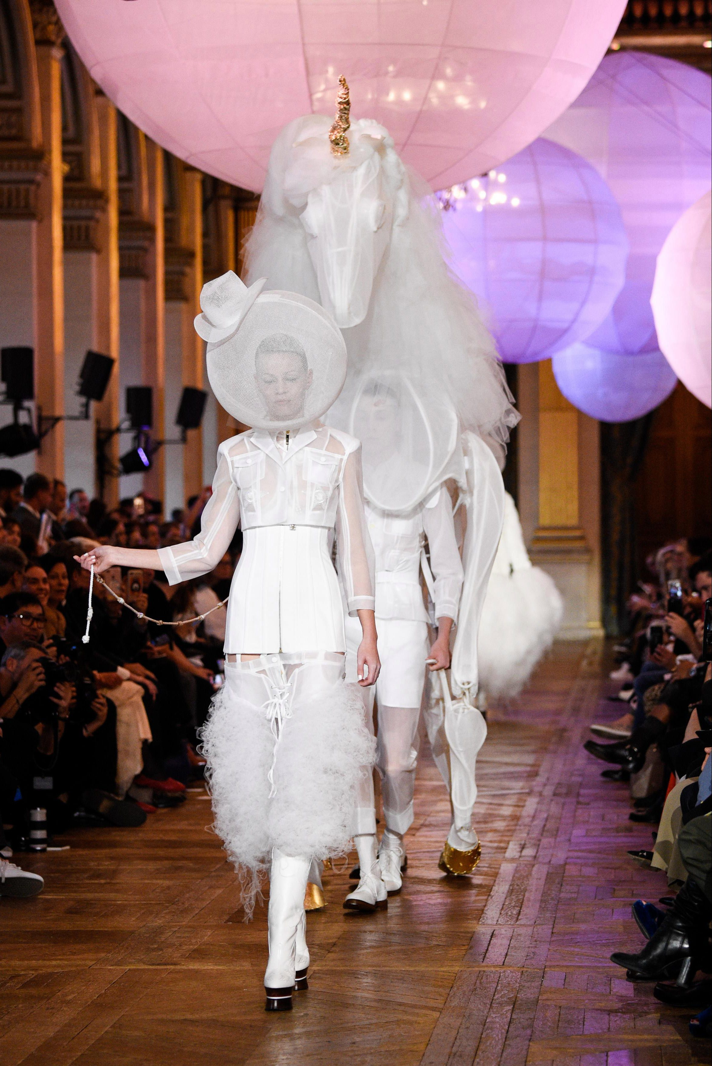 The finale of the runway show included a robotic unicorn dressed in a matching white lace look