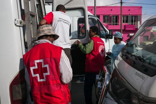 Red Cross officials work in Antananarivo, Madagascar, where the plague has struck