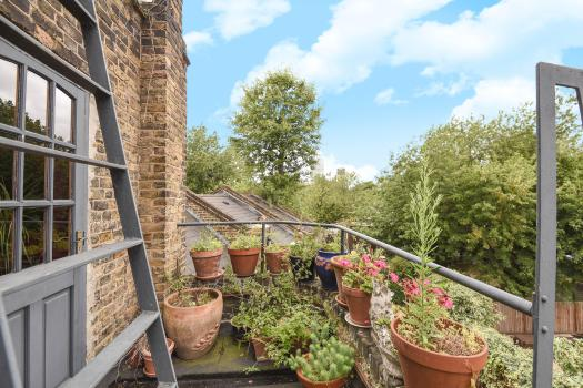 A roof terrace overlooks the East London the Ronnie and Reggie Kray once called home