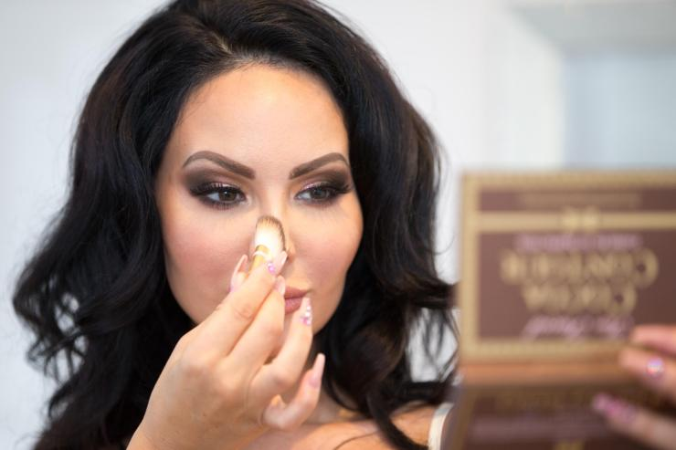 Star, pictured applying foundation, says she's happy being single