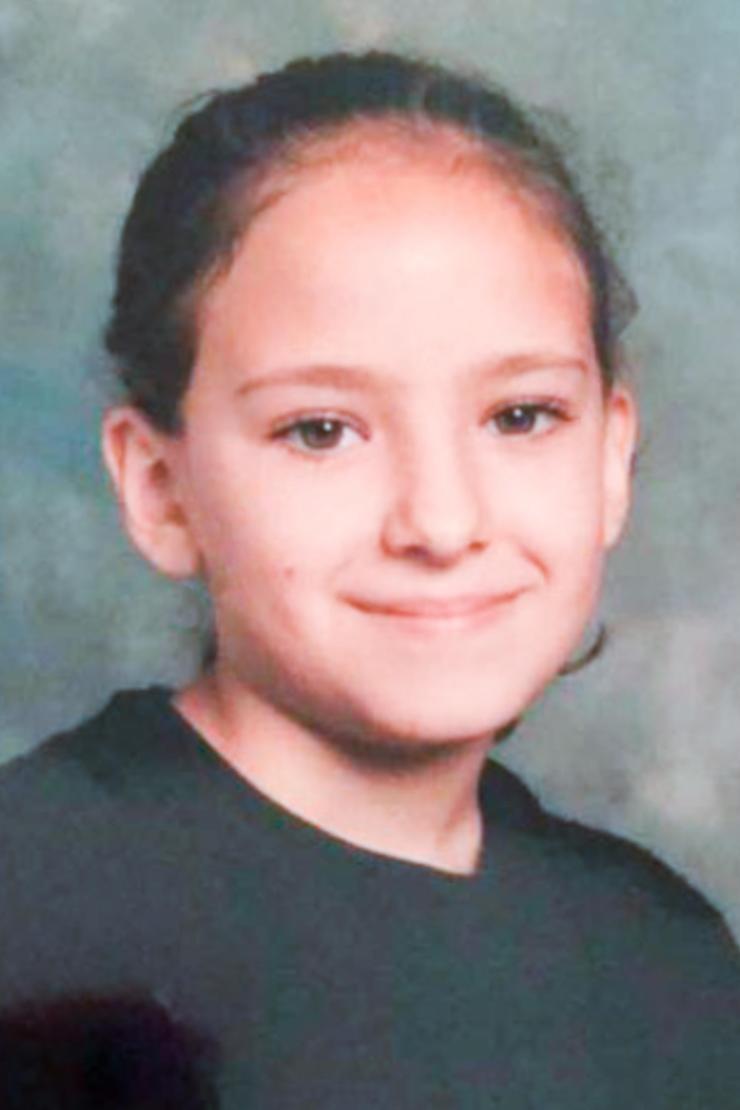 Star Delguidice, aged nine, posing for a school photograph