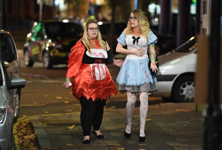 Fairy tales turned nasty in these costumes, with Alice in Wonderland covered in blood